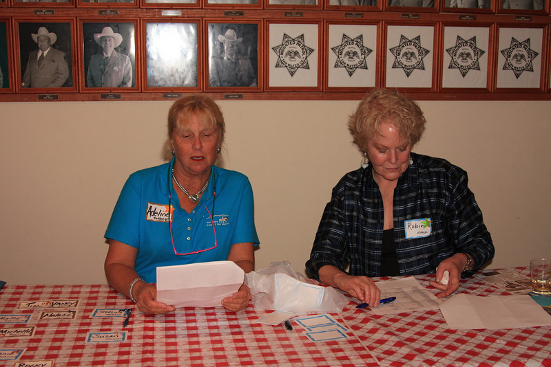 Adeline Forrest and Robin Whalen checking people in