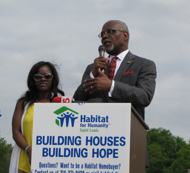 Charlie Dooley, County Executive of St. Louis County speaking with homebuyer, Lakisha in the background