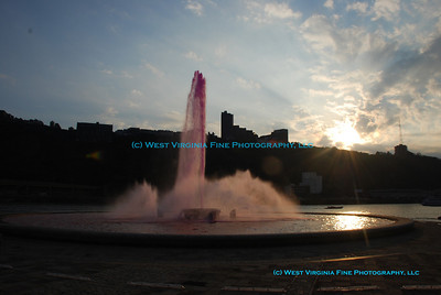 "The fountain at Point State Park in Pittsburgh, PA, tinted pink for the ""Pittsburgh 250"" celebration on Oct. 4, 2008."