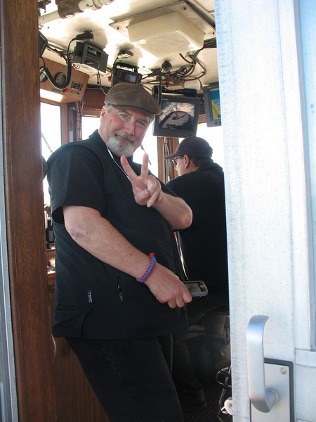 Eric flashes his V for Johnny V, while in the wheel house of the Phoenix