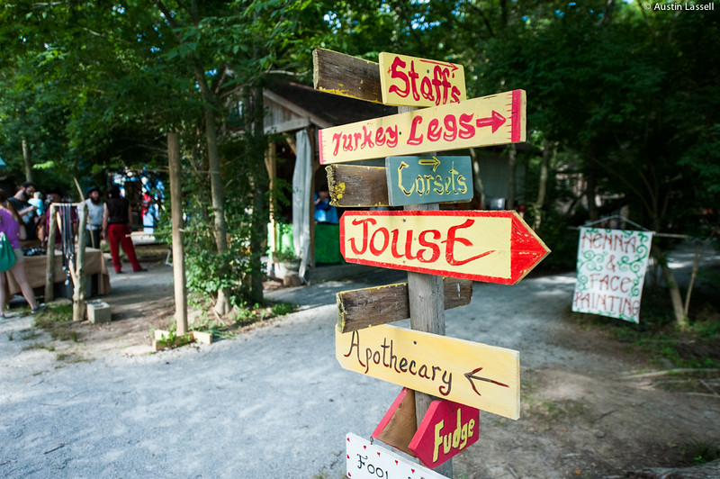 A signpost depicting the directions to numerous activities available during the annual 2014 Kentucky Renaissance Fair in Eminence, Ky.