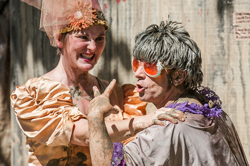 Performers for the Nuttin But Mud, Mud Show in a staged altercation. The performer on right is dressed as a mother-in-law of the prince which the performer on left is trying to marry. This was part of a performance on July 5, 2014 as part of the annual 2014 Kentucky Renaissance Fair in Eminence, Ky.