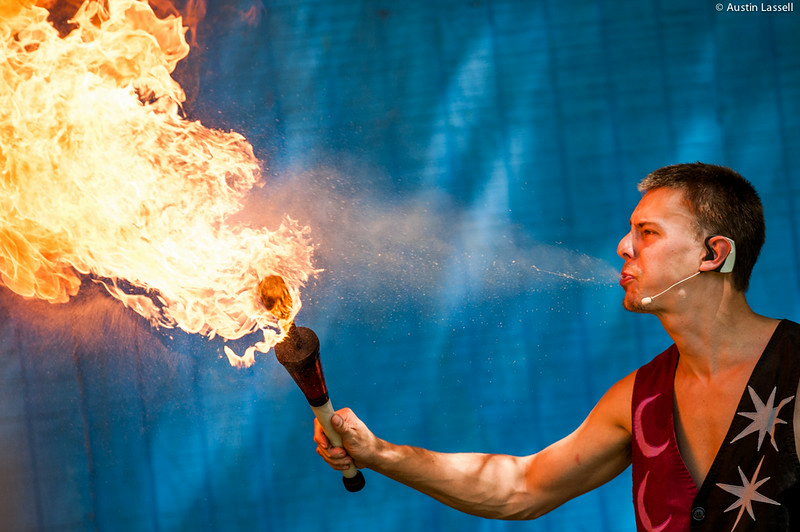 A juggler for the Pickled Brothers Sword Swallowing,  Fire Eating, Juggling Etc. spits alcholhol onto the open flame of a torch. This was  part of a performance on July 5, 2014 as part of the annual 2014 Kentucky Renaissance Fair in Eminence, Ky.