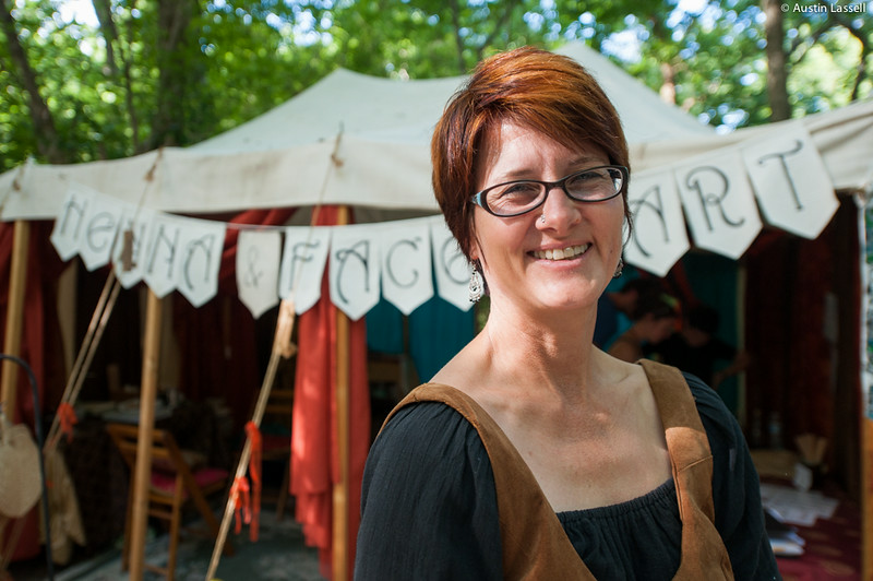 The owner/operator of a Henna and Face Art shop poses for a photo in front of her shop on July 5, 2014, during the annual 2014 Kentucky Renaissance Fair in Eminence, Ky.