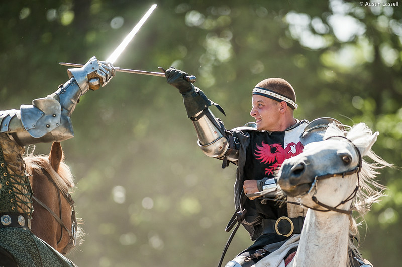 A performer for Roundtable Productions Jousting in a mock battle on horseback before jousting. In this show, the performer is acting as representing England. This was part of a performance on July 5, 2014 as part of the annual 2014 Kentucky Renaissance Fair in Eminence, Ky.