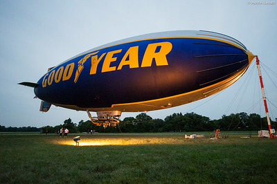 The Spirit of Innovation Goodyear blimp shortly after sunset. The Goodyear blimp has become more than simply a means for advertisement and televising, but an American symbol. Although there have been numerous Goodyear blimps over the years, indeed with three currently in operation, the image of the blimp is more than familiar to millions of Americans both attending events that the blimps cover and those seeing the blimp fly over their homes. With a slower cruise speed than many local streets, soft hum and large birthday balloon like appearance, the blimps can be a gentle reminder to relax for a minute and watch the clouds go by as calm as a blimp on a sunny day.
