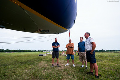 Local Louisville, Kentucky pilots speak with a mechanic overlooking the Spirit of Innovation N2A Goodyear blimp in town for the 2014 PGA Championships. Since the balloon needs to be in perfect balance around the clock, mechanics are posted 24/7 to watch over the blimp. As such, a good conversation with friendly, enthusiastic fellow aviators can help to pass the time.
