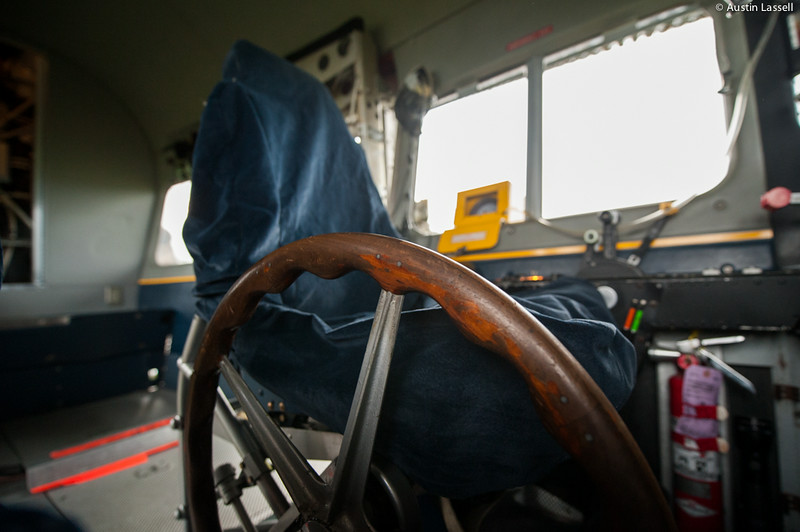 A close-up of the control wheel adjacent to the captain's seat of Goodyear's Spirit of Innovation blimp, tail number N2A. Unlike other aircraft that may use a yoke to pitch the aircraft up or down, the Goodyear blimp uses the wheel seen here to do so. The blimp acts much like a boat as compared to other aircraft, using buoyancy rather that the Bernoulli effect to remain aloft. This poses both a number of challenges and advantages for a blimp. Although environmental factors such as sunlight and rain effect blimps more strongly than other aircraft, a blimp is able to remain aloft essentially effortlessly as compared to other aircraft. This makes blimps, such as the Goodyear blimp, safe stable floating platforms ideal for mounting cameras to cover sporting events or lighted signs.