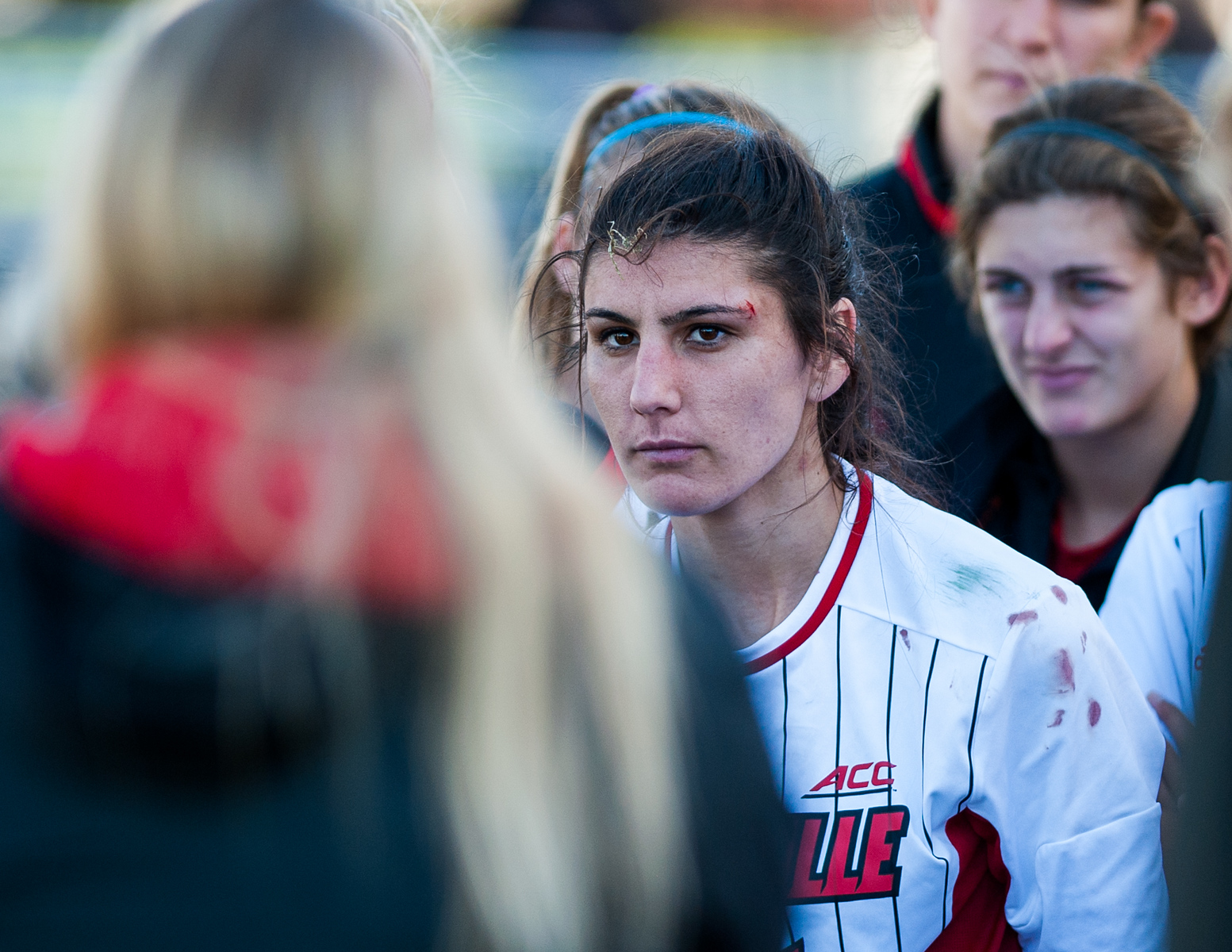 Chatham DeProspo (no. 11) of the women's soccer team listens to head coach Karen Ferguson-Dayes follwing a loss in a regular season game for the University of Louisville VS Virginia on 10-19-14 in Louisville, Kentucky at Lynn Stadium.