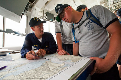 Midshipman Asaro 1st Classman teaching navigation to a USMMA 2nd Company candidate during an underway class on the bridge of the Training Vessel Liberator on July 14th, 2014. Given that the larger the vessel the larger the consequences are for an error, maneuvers must be well thought out and planned.