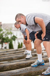 4th Company candidates overcoming an obstacle during obstacle course training at SUNY Maritime College on July 16th, 2014. In this obstacle candidates must carefully walk along two logs suspended above the ground.