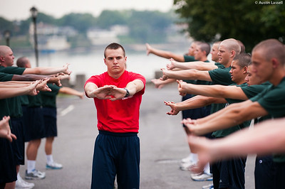 Midshipman Max Gaissle 1st Classman leads 1st Company Platoon 102  candidates in stretching prior to obstacle course training at SUNY Maritime College on July 14th, 2014.