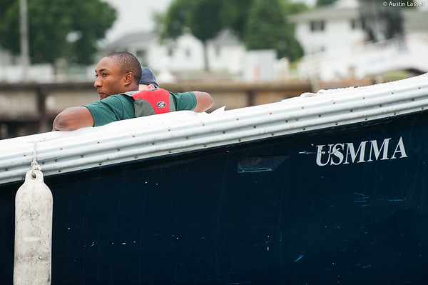 A 1st Company Platoon 102 candidate riding in a launcher returning to Merchant Marine Academy following obstacle course training at SUNY Maritime College on July 14th, 2014.