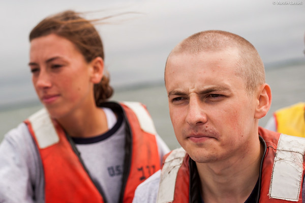A 4th Company candidate pays careful attention while at the helm and follows the instruction of of Midshipman William Lassell 3rd Classman (not seen) during small boats class on July 16th, 2014. The Whaler is capable of considerable speeds, making careful maneuvering and navigation very important.