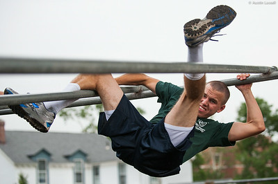 A 1st Company Platoon 102 candidate overcoming an obstacle during obstacle course training at SUNY Maritime College on July 14th, 2014. In this obstacle candidates must straddle down two metal bars.