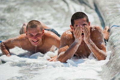 A candidate wipes the soap from his eyes after going down the giant slip and slide that is part of the end of Indoctrination Waterfront Games on July 20th, 2014.
