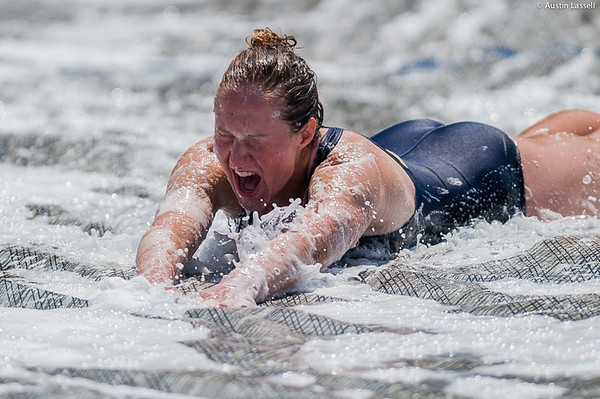 A candidate excitedly goes down the giant slip and slide that is part of the end of Indoctrination Waterfront Games on July 20th, 2014.