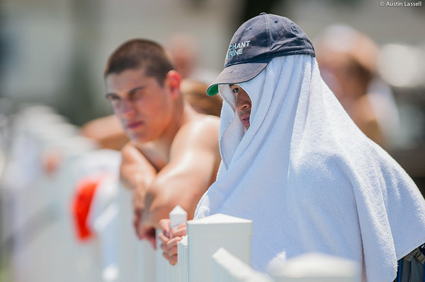 A candidate wears a towel in order to keep cool while awaiting the start of the Waterfront Games on July 20th, 2014. At the conclusion of indoctrination candidates are given the chance to relax and let loose through a series of carefree games held at the Waterfront.