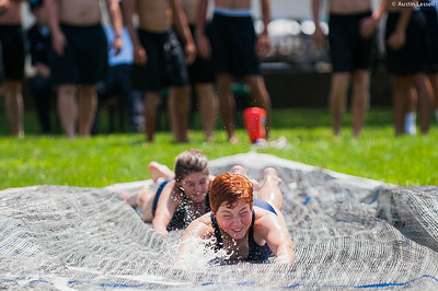 Candidate excitedly go down the giant slip and slide that is part of the end of Indoctrination Waterfront Games on July 20th, 2014.
