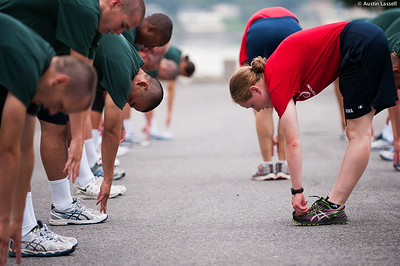 Midshipman Jackie White 1st Classman leads 1st Company Platoon 102  candidates in stretching prior to obstacle course training at SUNY Maritime College on July 14th, 2014.