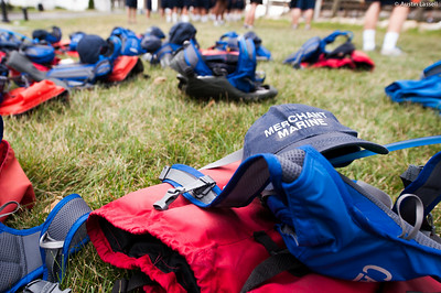 Some standard equipment belonging to 1st Company Platoon 102  candidates, sitting in small piles while candidates participate in obstacle course training at SUNY Maritime College on July 14th, 2014.