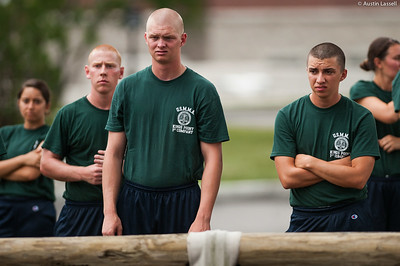 1st Company Platoon 102 candidates looking intently at obstacles to be overcome in obstacle course training at SUNY Maritime College on July 14th, 2014.