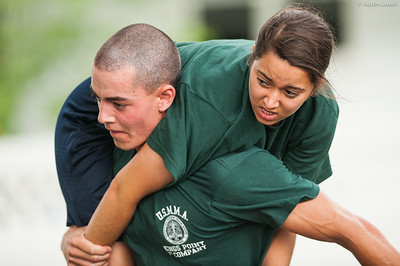 1st Company Platoon 102 candidate Morris being carried during a man down drill portion of the obstacle course during obstacle course training at SUNY Maritime College on July 14th, 2014. The purpose of this portion of the training is to test the candidate's ability at carrying a downed mariner.