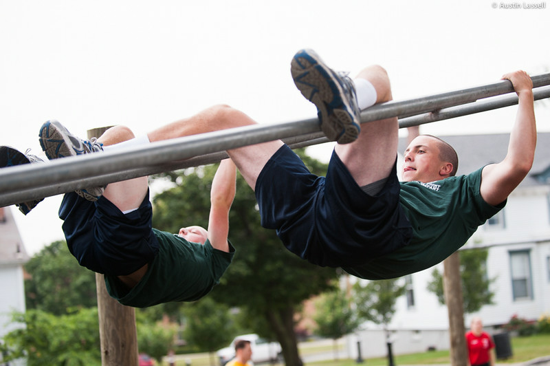 1st Company Platoon 102 candidates overcoming an obstacle during obstacle course training at SUNY Maritime College on July 14th, 2014. In this obstacle candidates must straddle down two metal bars.