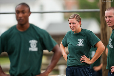 1st Company Platoon 102 candidate Jenna Wetherington taking a moment to rest after completing the  obstacle course during obstacle  training at SUNY Maritime College on July 14th, 2014.