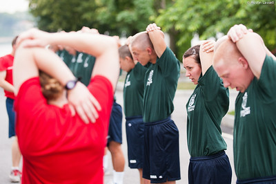 1st Company Platoon 102 candidates stretching prior to obstacle course training at SUNY Maritime College on July 14th, 2014.