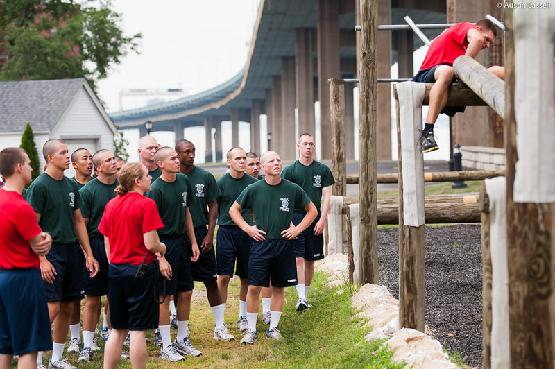 Midshipman Frank Syscko 1st Classman CTO1 (1st company training officer) demonstrating obstacle to 1st Company Platoon 102 candidates prior to obstacle course training at SUNY Maritime College on July 14th, 2014.