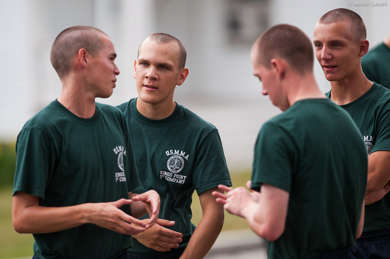 1st Company Platoon 102 candidates speaking with each-other  concerning obstacle course training at SUNY Maritime College on July 14th, 2014.
