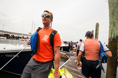 Midshipman Sam Hagen 2nd Classman carries life jackets and other items off the dock following obstacle course training at SUNY Maritime College on July 16th, 2014.
