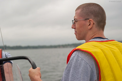 A 4th Company candidate pauses for a moment during small boats class on July 16th, 2014. This candidate, and his fellow candidates, is being given proper instruction on the operation of a small boat by Midshipman William Lassell 3rd Classman.