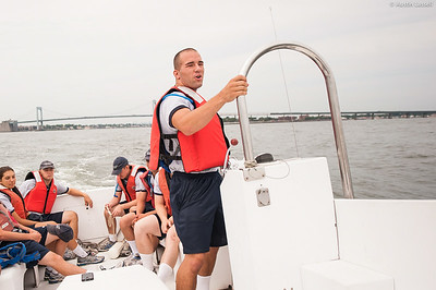 4th Company candidate at the helm of a launcher returning to campus following obstacle course training at SUNY Maritime College on July 16th, 2014. This candidate, and his fellow candidates are being led by Midshipman Nick Gioino 3rd Classman.
