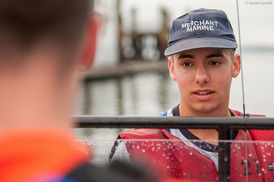 A 4th Company candidate at the helm of a Whaler for small boats class on July 16th, 2014. This candidate, and his fellow candidates, is being given proper instruction on the operation of a small boat by Midshipman William Lassell 3rd Classman.