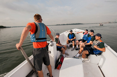 Midshipman Andrew 3rd Classman bringing  1st Company Platoon 102 candidates in a Launcher out for a small boats class on July 14th, 2014. Midshipman Andrews teaches the candidates the basic  maneuvering operations of a small boat in open water.