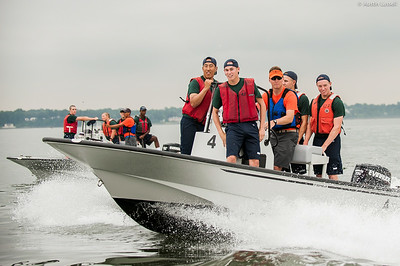 Midshipman Samuel Kevetter piloting a Whaler with 3rd Classman bringing United States Merchant Marine Academy 1st Company Platoon 102 candidates on board headed to obstacle course training at SUNY Maritime College on July 14th, 2014. candidates on board headed to obstacle course training at SUNY Maritime College on July 14th, 2014.