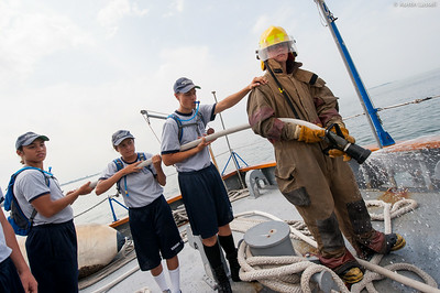 USMMA 2nd Company candidates act as hose team 2 performing a fire drill at the stern of the ship with a live hose during fire training on the Training Vessel Liberator during an underway class on July 14th, 2014.