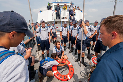 Midshipman Ed Pajus 1st Classman speaks with USMMA 2nd Company candidates following a simulated man overboard drill during an underway class on the Training Vessel Liberator on July 14th, 2014. Midshipman Pajus mentions that once the person is brought onboard the ship they may need medical treatment depending on the circumstances following the incident.
