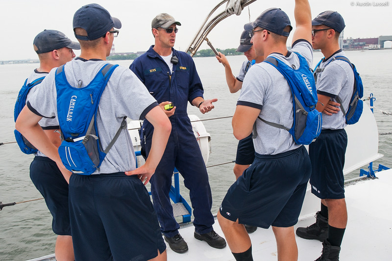 Midshipman Paul Styx 1st Classman teaches 2nd Company candidates about the lifeboat vhf radio. during an underway class on the Training Vessel Liberator on July 14th, 2014. The lifeboat vhf radio is used for communicating from lifeboat to ship during an emergency.