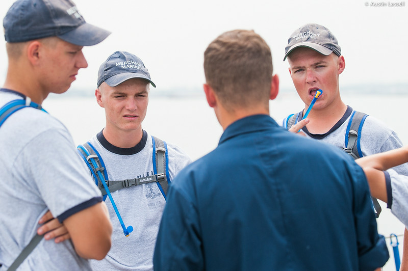 USMMA 2nd Company candidates listen intently to Midshipman Ed Pajus 1st Classman speak about fire training during an underway class on the Training Vessel Liberator on July 14th, 2014.