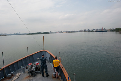 Two military servicemen stand on the bow during an underway class on the Training Vessel Liberator on July 14th, 2014.