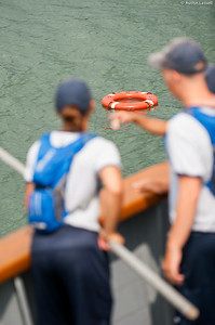USMMA 2nd Company candidates prepare at the bow of the ship to pull in a life preserver being used to represent a person during a simulated man overboard drill during an underway class on the Training Vessel Liberator on July 14th, 2014.