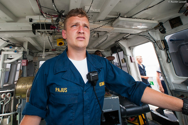 Midshipman Ed Pajus 1st Classman practicing being in charge of the con during an underway class on the Training Vessel Liberator on July 14th, 2014.