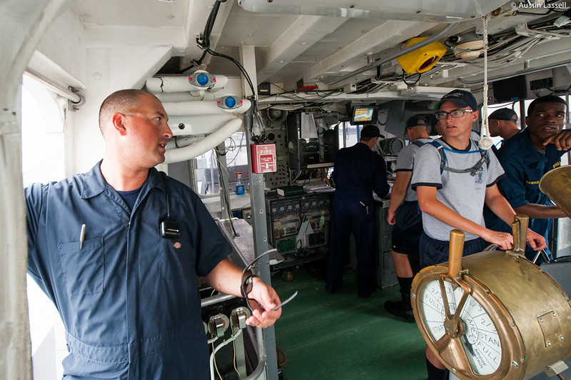 Captain Jonathan Kabak comments on navigational duties on a large vessel to 2nd Company Candidates during an underway class on the bridge of the training vessel Liberator July 14th, 2014.
