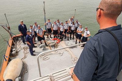 Captain Jonathan Kabak speaks with USMMA 2nd Company candidates following a simulated man overboard drill during an underway class on the Training Vessel Liberator on July 14th, 2014. Captain Kabak comments on the relative importance of stations on a larger vessel during emergencies. Should a problem arise, good training is the best way to ensure a quick response to the situation, improving the overall outcome.