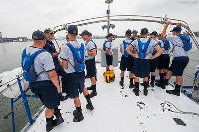USMMA 2nd Company candidates stand on the stern of the ship and listen to Midshipmen teach about numerous emergency signaling devices on a large vessel during an underway class on the Training Vessel Liberator on July 14th, 2014.
