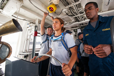 Midshipman Samuels 3rd Classman overlooks as a USMMA 2nd Company candidate is at the helm during an underway class on the Training Vessel Liberator on July 14th, 2014.