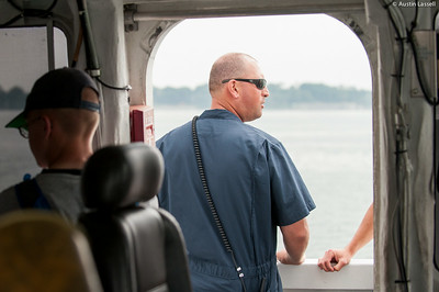 Captain Jonathan Kabak assists with lookout in the navigation of liberator during an underway class on the Training Vessel Liberator on July 14th, 2014.